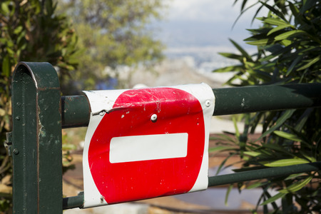 No entry sign placed on a fence door in Lycabettus hill, Athens