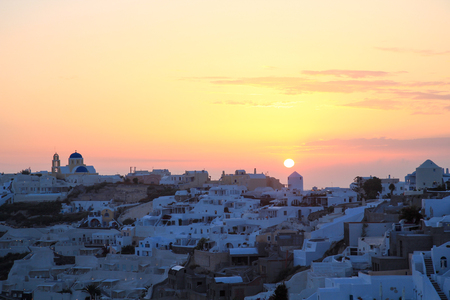 View of Oia village in Santorini island, Greece, during a summer time sunset Stock Photo