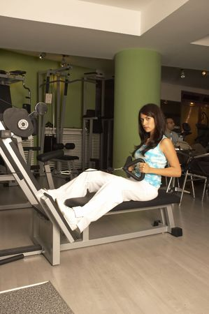 Woman practices and resting in Gym photo
