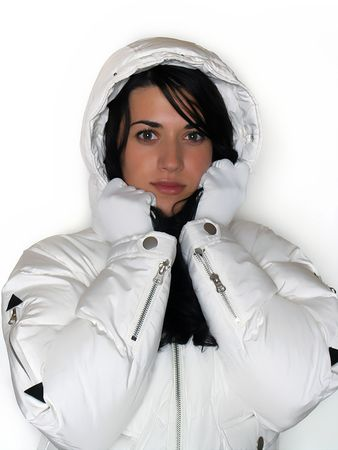waterproof: Young woman with white winter coat Stock Photo