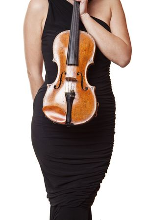 Woman in black dress holding violin in hand photo