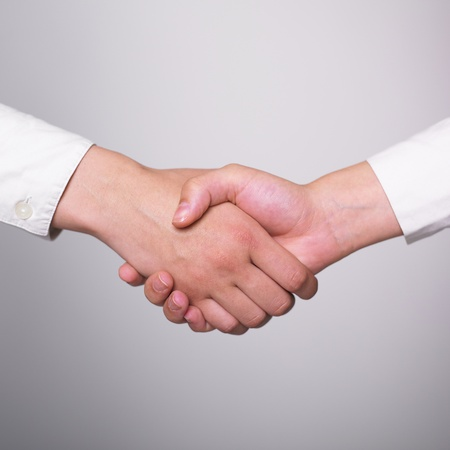 Two hands in Handshake - Business Handshaking Stock Photo - 9423627