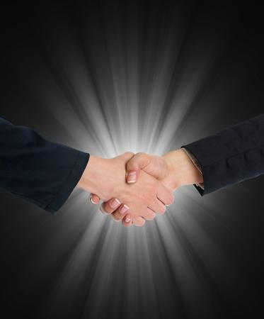 good bey: Hand shake over blurred grey flesh light background