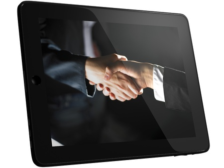 Handshake on Tablet PC Computer, isolated photo