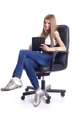 Beautiful Young Woman Using Tablet Computer On Office Chair Stock Photo - 11267743