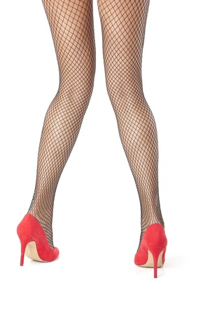 Sexy woman crosing legs in fishnet stocking posing