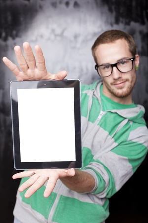 Good Looking Young Nerd Smart Guy Man Using Tablet Computer photo