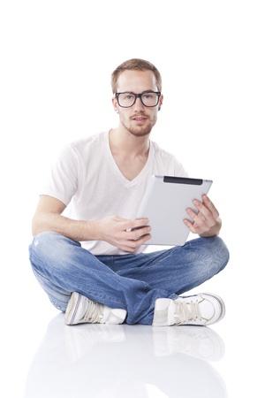 Good Looking Young Nerd Smart Guy Man Using Tablet Computer Stock Photo