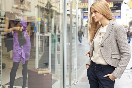 Customer woman in shoping street, looking at window, outdoor Stock Photo