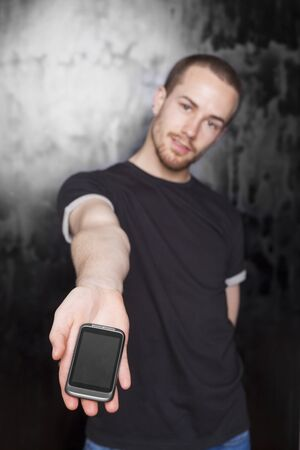 Young Men holding smartphone Stock Photo - 13226819