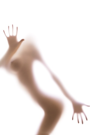 big breast: Sexy silhouette behind the blurred glass of bathroom, hands and fingers