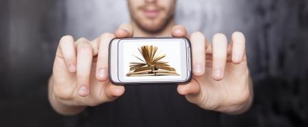 paper screens: Men showing screen of smart phone, on display are open book, studio shot
