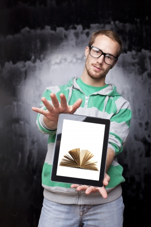 Good Looking Young Nerd Smart Guy Man Using Tablet Computer - Digital library