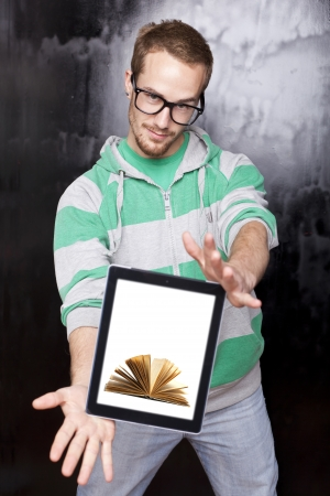 Digital library - Young Smart Guy Man Using Tablet Computer photo