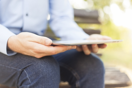 Businessman Using Tablet Computer in park photo