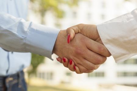 Two hands in Handshake - Businesspeople Handshaking