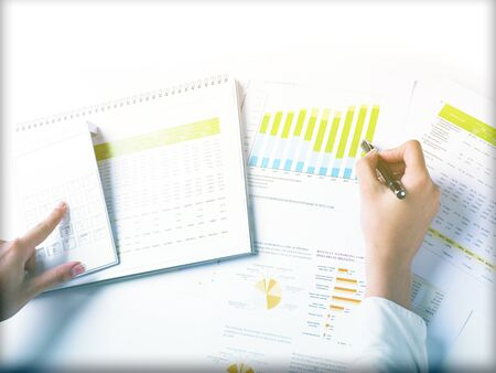 Market Analyze - pen and numbers on paper Stock Photo - 15214049