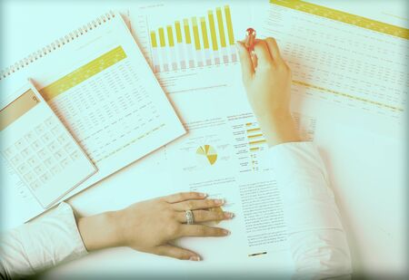 Market Analyze - pen and numbers on paper Stock Photo - 15214099