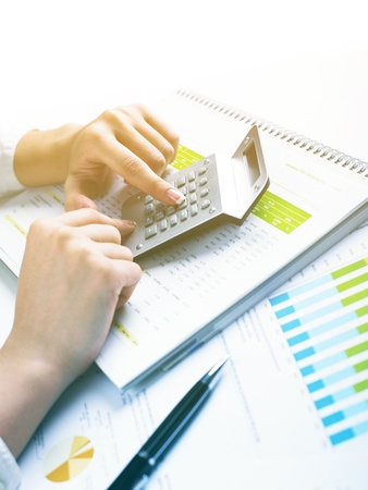 Analyzing Business Data - pen and numbers on paper Stock Photo - 15214042