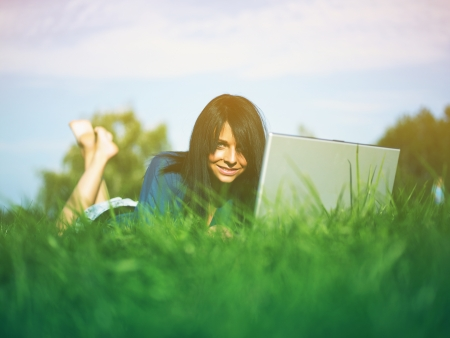 Young woman using laptop in park Stock Photo - 14932814