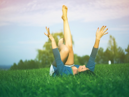 Young woman relaxing in park on green grass Stock Photo - 14932837