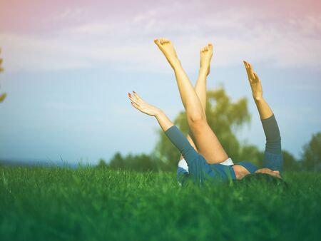 Young woman relaxing in park on green grass Stock Photo - 14932828