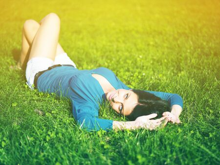 Young woman relaxing in park on green grass Stock Photo - 14932854