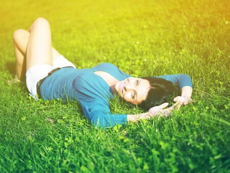 Young woman relaxing in park on green grass Stock Photo - 14932855