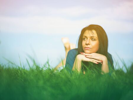 Young woman relaxing in park on green grass Stock Photo - 14932810