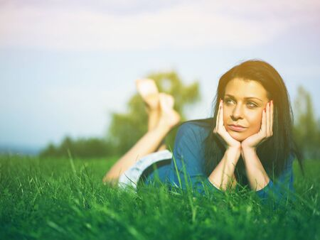 Young woman relaxing in park on green grass Stock Photo - 14932840