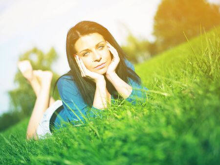 Young woman relaxing in park on green grass Stock Photo - 14932846