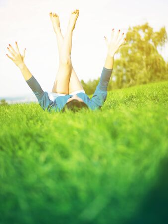 Young woman relaxing in park on green grass Stock Photo - 14932827
