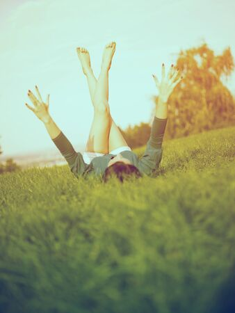 Young woman relaxing in park on green grass Stock Photo - 14932812
