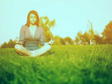 Young woman relaxing in park on green grass Stock Photo - 14932830