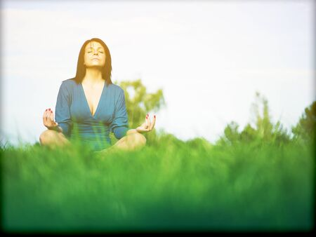 Young woman relaxing in park on green grass Stock Photo - 14932806