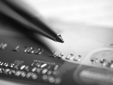 Close up a credit card and pen Stock Photo - 15214100