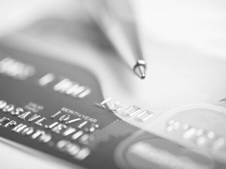 Close up a credit card and pen Stock Photo - 15214097