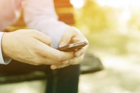 smartphone in hand, blurred background, instagrame colors Stock Photo