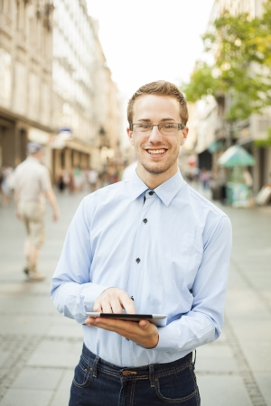 Businessman Man Using Tablet Computer in public space Stock Photo - 17456073