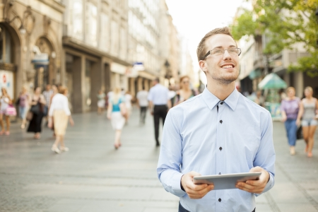Businessman Using Tablet Computer in public space Stock Photo - 17456077