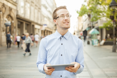 Businessman Man Using Tablet Computer in public space, street, city Stock Photo - 17456082