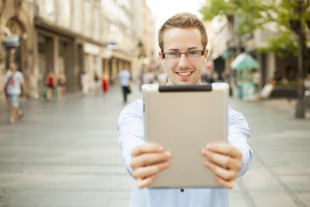 Businessman man hold tablet computer in public space Stock Photo - 17456093