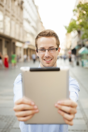 Businessman Using Tablet Computer in public space Stock Photo - 17456067