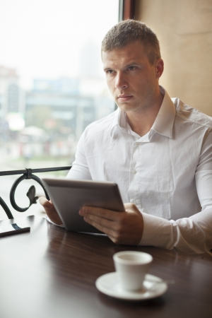 Businessman on Coffee break in restaurant - face in focus Stock Photo - 18686340
