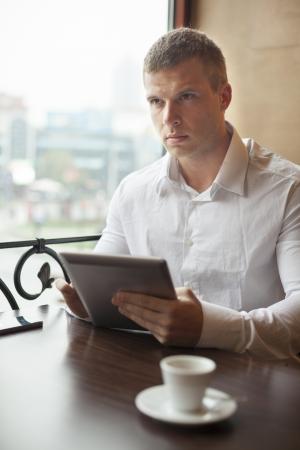 Businessman on Coffee break in restaurant - face in focus Stock Photo - 18686340