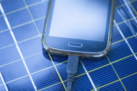 Solar Mobile Phone Chargers on grass in nature photo