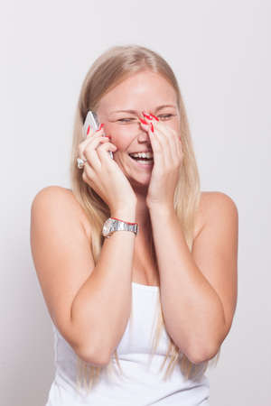 tenager: Young Woman With Phone Speaking and laughing Stock Photo