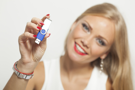 usb memory: Smiling Blonde Woman With USB Memory In Hands