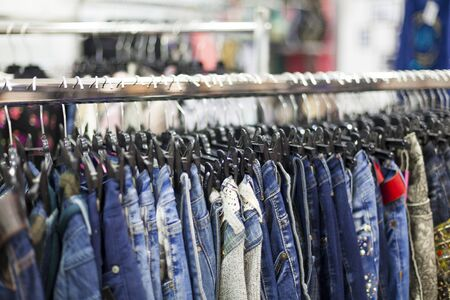 clothing store: Clothes Rack With Jeans- Clothing Store Detail