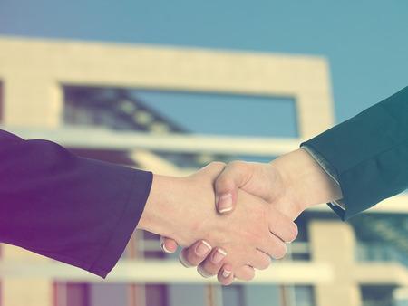good bey: Handshake Handshaking and blured building in background Stock Photo